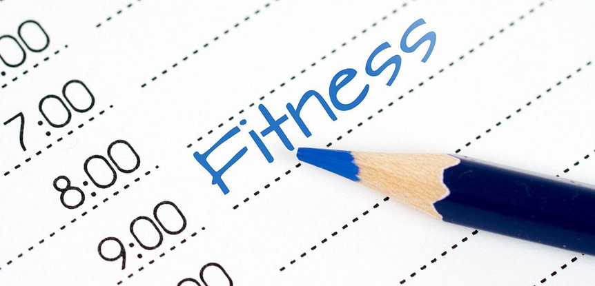 "How long does it take to get fit. Day calendar with the word ""Fitness"" in blue pencil scheduled for 9:00."