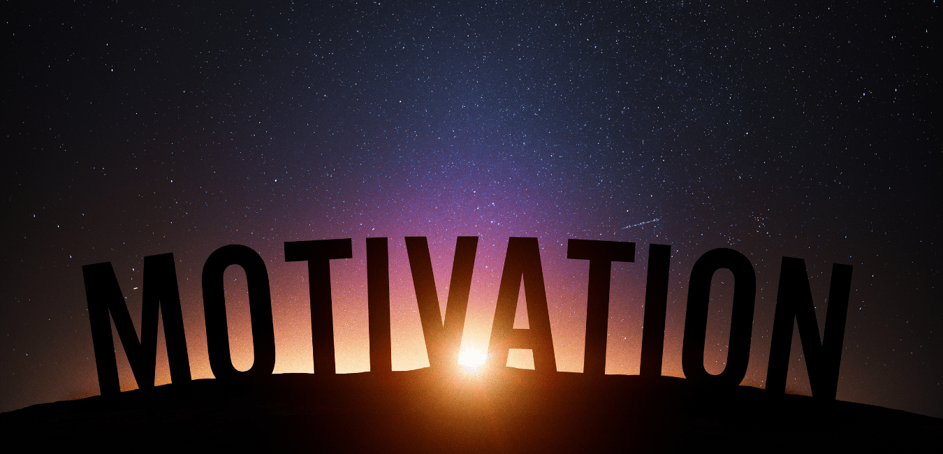 Expert tips on how to get motivated during the new year. The work motivation in block letters over the horizon of a sunset.